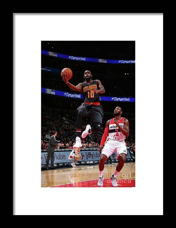 Tim Hardaway Jr. Framed Print featuring the photograph Atlanta Hawks V Washington Wizards by Ned Dishman