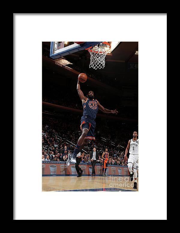 Tim Hardaway Jr. Framed Print featuring the photograph Brooklyn Nets V New York Knicks by Nathaniel S. Butler