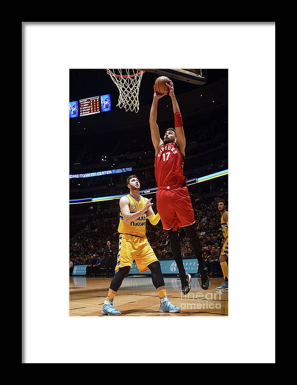 Nba Pro Basketball Framed Print featuring the photograph Toronto Raptors V Denver Nuggets by Garrett Ellwood