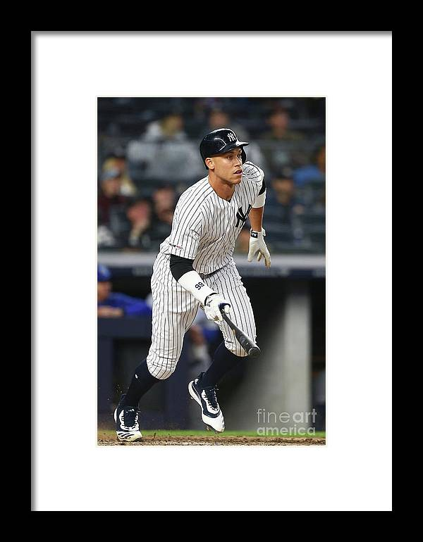 People Framed Print featuring the photograph Kansas City Royals V New York Yankees 16 by Mike Stobe