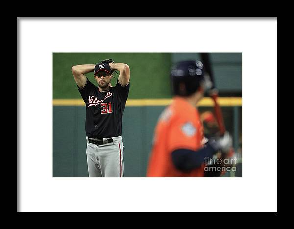 People Framed Print featuring the photograph World Series - Washington Nationals V 16 by Mike Ehrmann