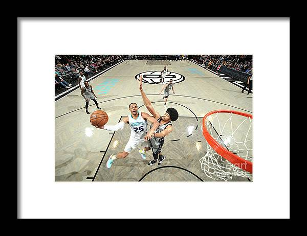 Nba Pro Basketball Framed Print featuring the photograph Charlotte Hornets V Brooklyn Nets by Nathaniel S. Butler