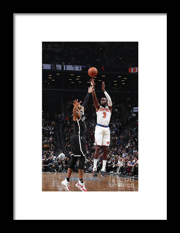 Tim Hardaway Jr. Framed Print featuring the photograph New York Knicks V Brooklyn Nets by Nathaniel S. Butler