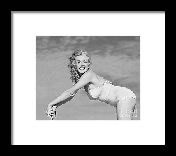 Three Quarter Length Framed Print featuring the photograph Portrait Of Marilyn Monroe by Andre De Dienes