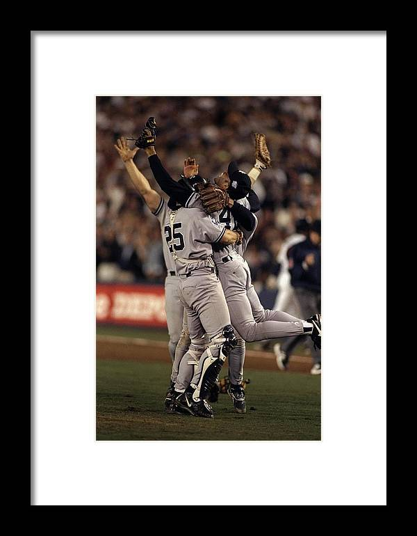 Following Framed Print featuring the photograph 1998 World Series 1998 by Al Bello