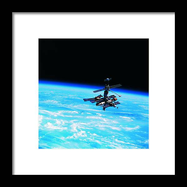 Alertness Framed Print featuring the photograph A Space Station Orbiting Above Earth by Stockbyte