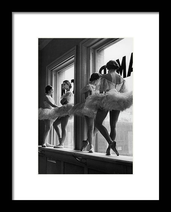 Ballet Dancer Framed Print featuring the photograph Ballerinas Standing On Window Sill In by Alfred Eisenstaedt