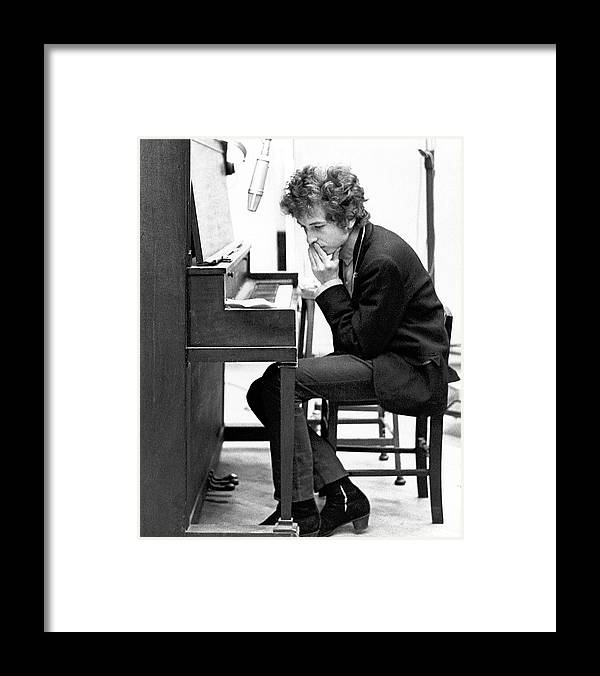 Bob Dylan Framed Print featuring the photograph Bob Dylan Records Highway 61 Revisited by Michael Ochs Archives