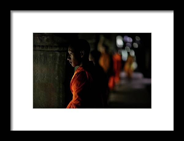 People Framed Print featuring the photograph Buddhist Monks At Angkor Wat Temple by Timothy Allen