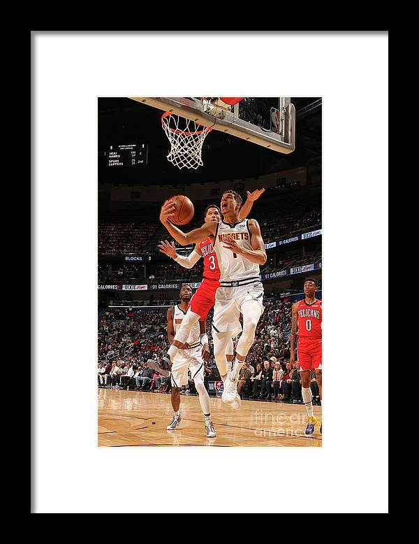 Smoothie King Center Framed Print featuring the photograph Denver Nuggets V New Orleans Pelicans by Layne Murdoch Jr.