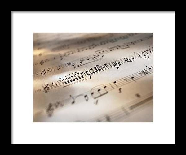 Sheet Music Framed Print featuring the photograph Detail Of Sheet Music by Ryan Mcvay