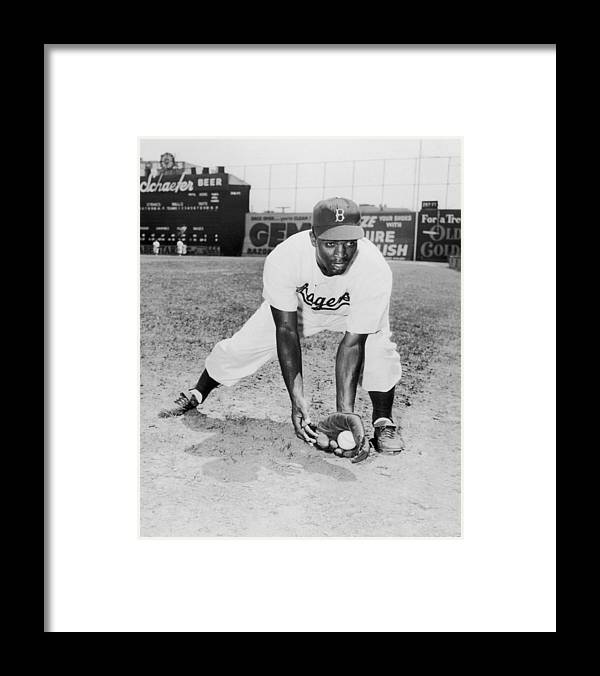 Jackie Robinson Framed Print featuring the photograph Jackie Robinson by Hulton Archive
