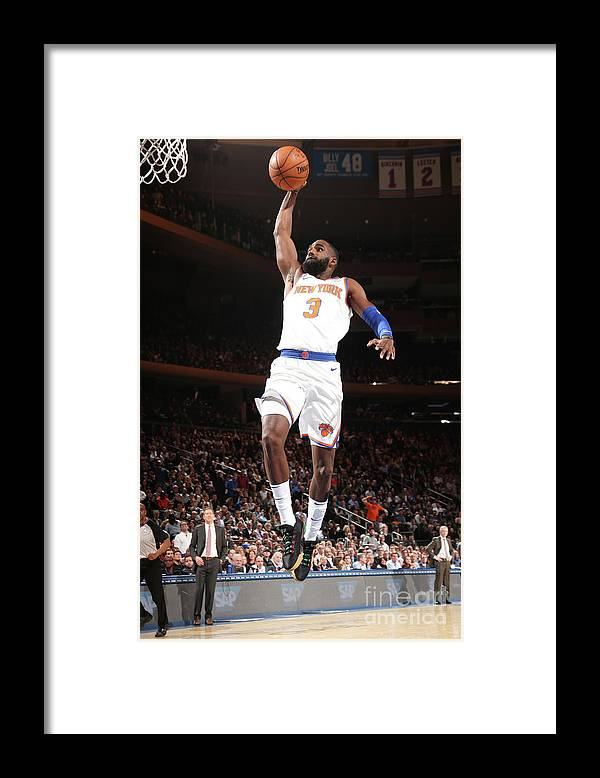 Tim Hardaway Jr. Framed Print featuring the photograph Milwaukee Bucks V New York Knicks by Ned Dishman