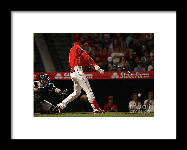People Framed Print featuring the photograph New York Yankees V Los Angeles Angels by Victor Decolongon
