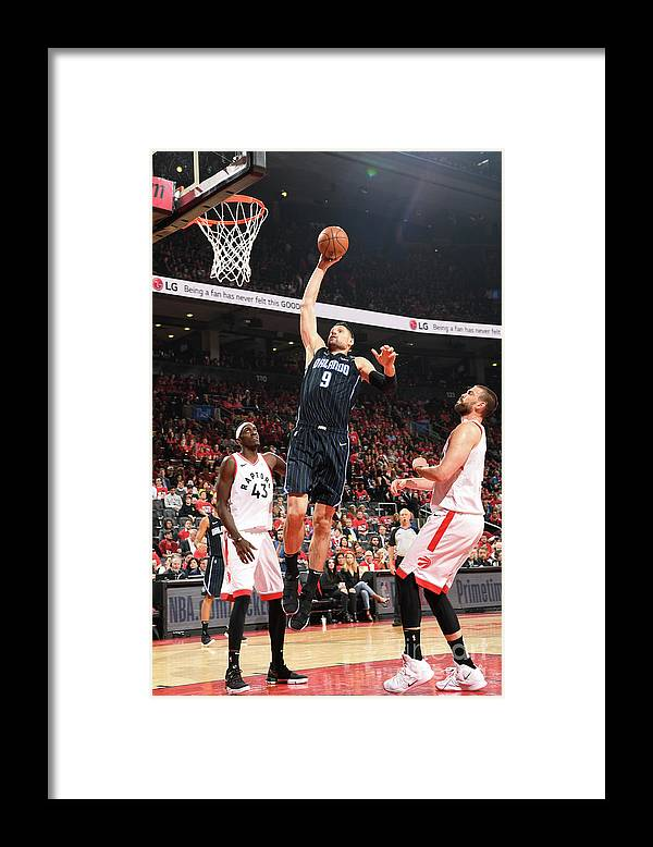 Playoffs Framed Print featuring the photograph Orlando Magic V Toronto Raptors - Game by Ron Turenne