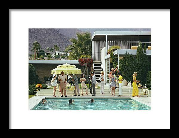 People Framed Print featuring the photograph Poolside Party 2 by Slim Aarons