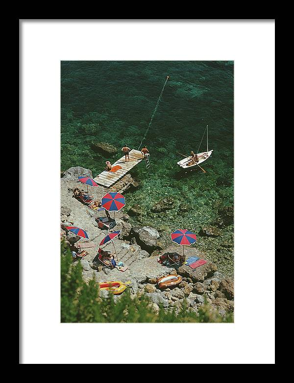 People Framed Print featuring the photograph Porto Ercole by Slim Aarons