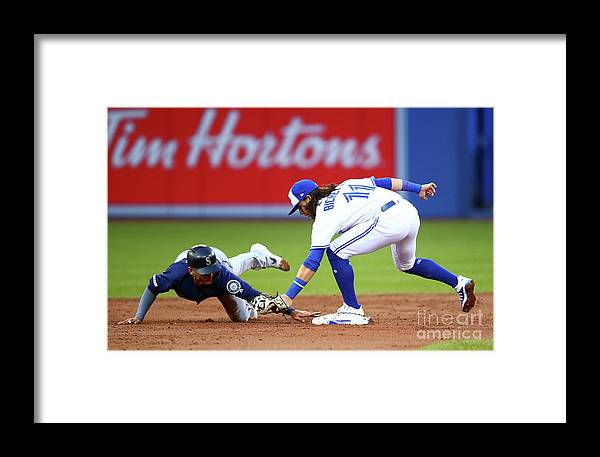 People Framed Print featuring the photograph Seattle Mariners V Toronto Blue Jays by Vaughn Ridley