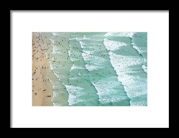 Water's Edge Framed Print featuring the photograph Swimmers And Surfers On Beach, Aerial by Jason Hawkes