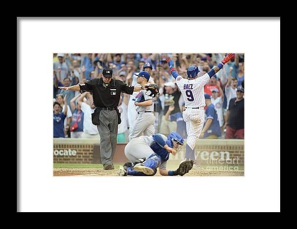 People Framed Print featuring the photograph Toronto Blue Jays V Chicago Cubs by Stacy Revere