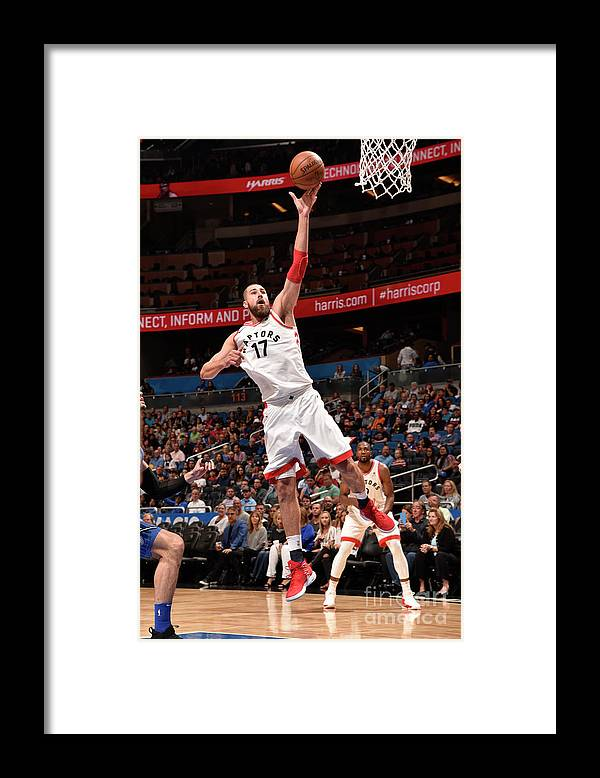 Nba Pro Basketball Framed Print featuring the photograph Toronto Raptors V Orlando Magic by Gary Bassing