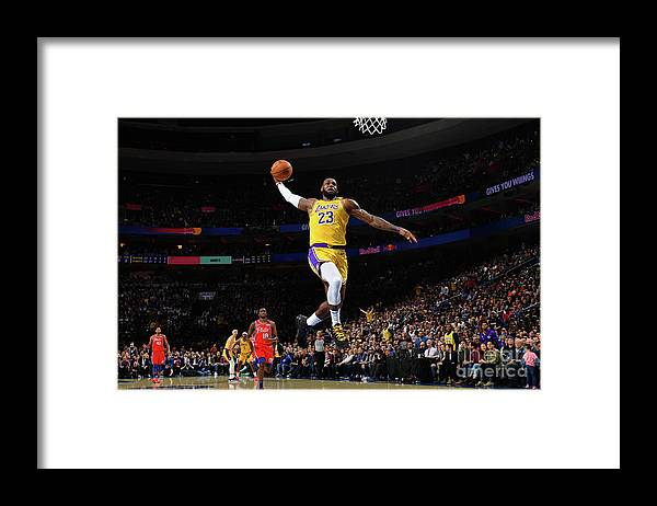 Nba Pro Basketball Framed Print featuring the photograph Lebron James by Jesse D. Garrabrant
