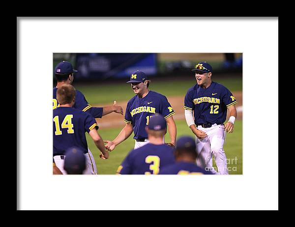 Working Framed Print featuring the photograph Michigan V Ucla - Game One by Jayne Kamin-oncea