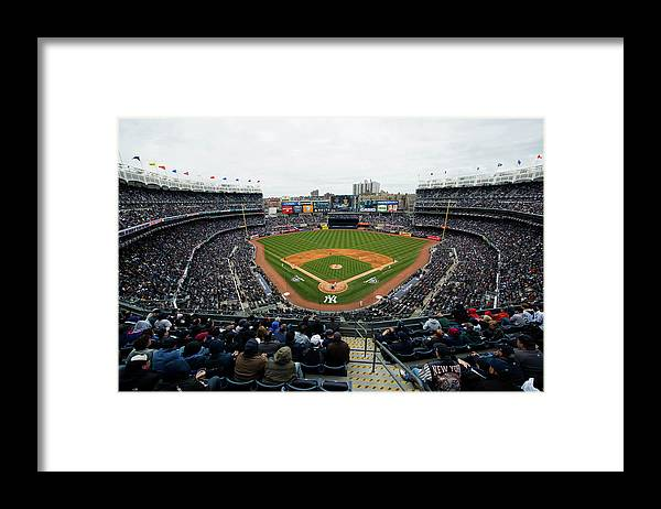 East Framed Print featuring the photograph Baltimore Orioles V. New York Yankees by Rob Tringali