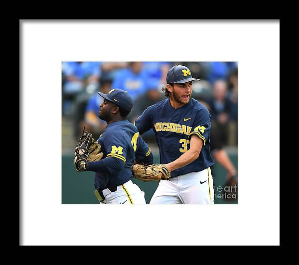 Three Quarter Length Framed Print featuring the photograph Michigan V Ucla - Game One by Jayne Kamin-oncea