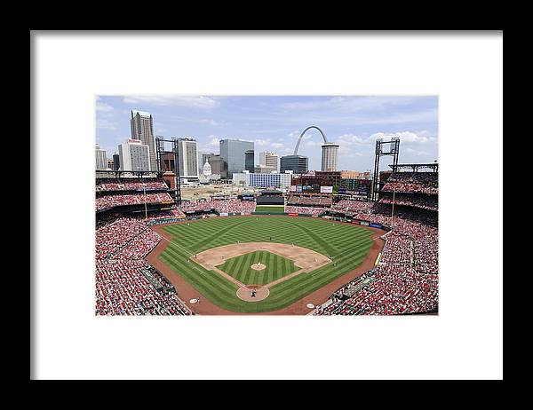 St. Louis Cardinals Framed Print featuring the photograph Cincinnati Reds V. St. Louis Cardinals by Ron Vesely