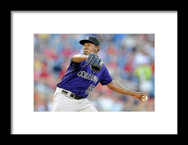 American League Baseball Framed Print featuring the photograph Colorado Rockies V Washington Nationals by Greg Fiume