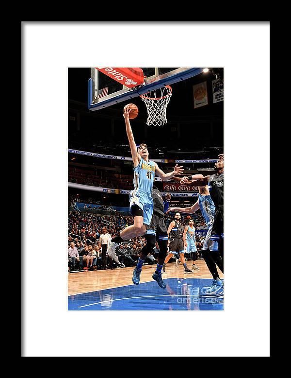Nba Pro Basketball Framed Print featuring the photograph Denver Nuggets V Orlando Magic by Fernando Medina