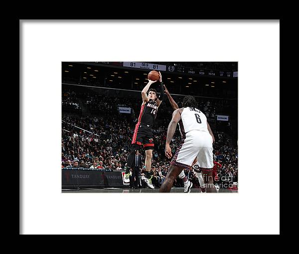 Tyler Herro Framed Print featuring the photograph Miami Heat V Brooklyn Nets by Nathaniel S. Butler