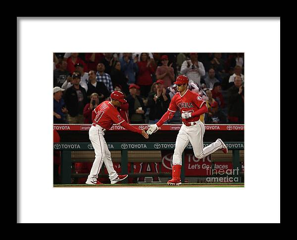 Second Inning Framed Print featuring the photograph New York Yankees V Los Angeles Angels by Victor Decolongon