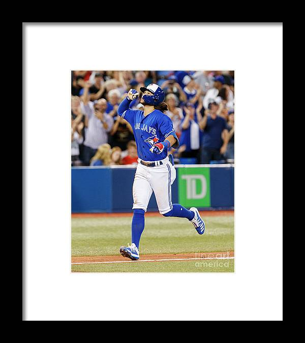 People Framed Print featuring the photograph New York Yankees V Toronto Blue Jays by Mark Blinch