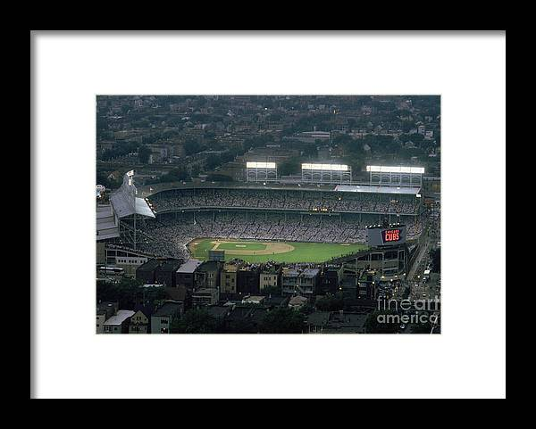 1980-1989 Framed Print featuring the photograph Wrigley Field by Jonathan Daniel