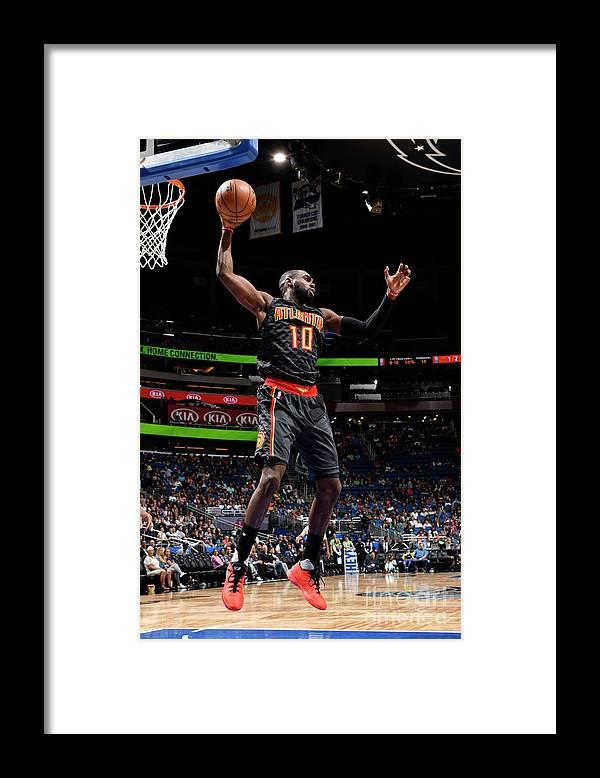 Tim Hardaway Jr. Framed Print featuring the photograph Atlanta Hawks V Orlando Magic by Fernando Medina