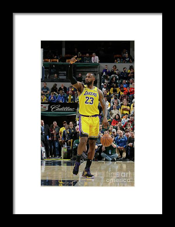 Nba Pro Basketball Framed Print featuring the photograph Lebron James by Ron Hoskins