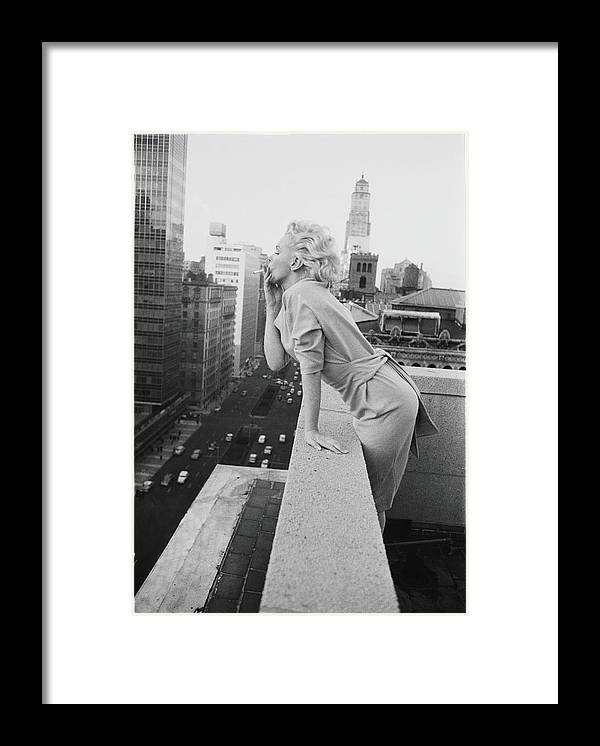 Smoking Framed Print featuring the photograph Marilyn On The Roof by Michael Ochs Archives