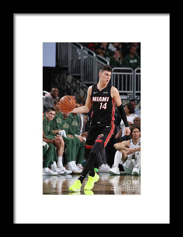 Tyler Herro Framed Print featuring the photograph Miami Heat V Milwaukee Bucks by Gary Dineen