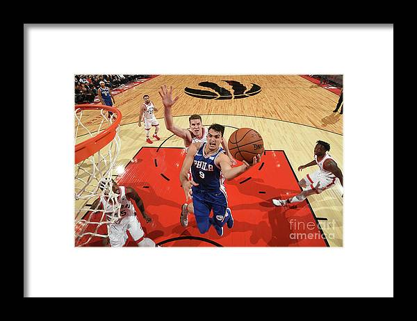 Nba Pro Basketball Framed Print featuring the photograph Philadelphia 76ers V Toronto Raptors by Ron Turenne