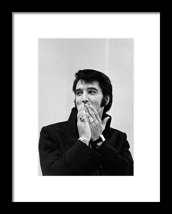 Elvis Presley Framed Print featuring the photograph Rock And Roll Musician Elvis Presley by Michael Ochs Archives