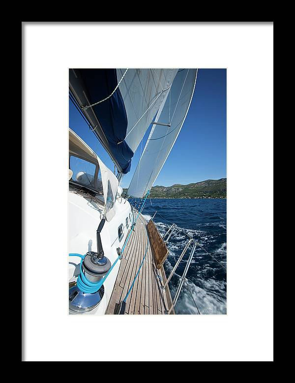 Curve Framed Print featuring the photograph Sailing In The Wind With Sailboat by Mbbirdy