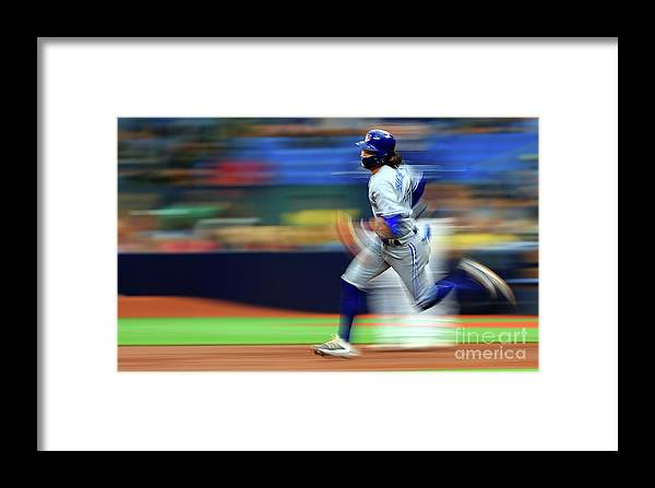 People Framed Print featuring the photograph Toronto Blue Jays V Tampa Bay Rays by Mike Ehrmann