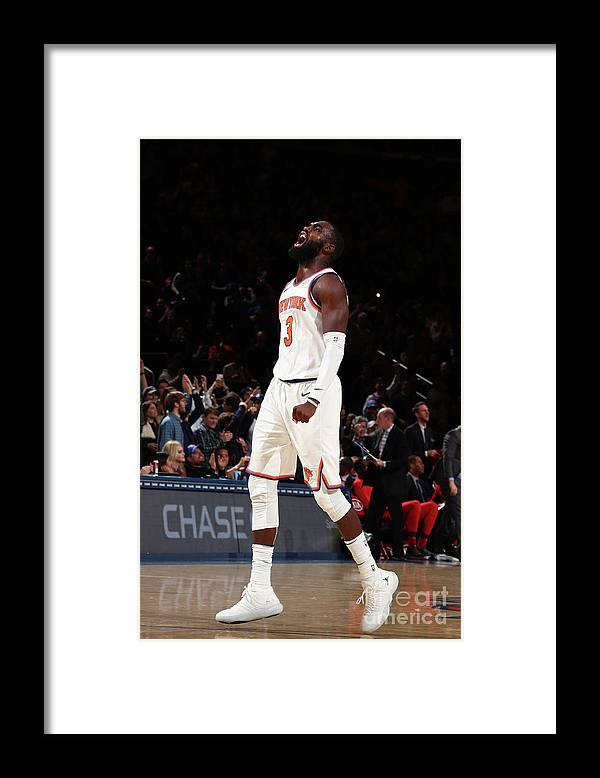 Tim Hardaway Jr. Framed Print featuring the photograph Toronto Raptors V New York Knicks by Nathaniel S. Butler