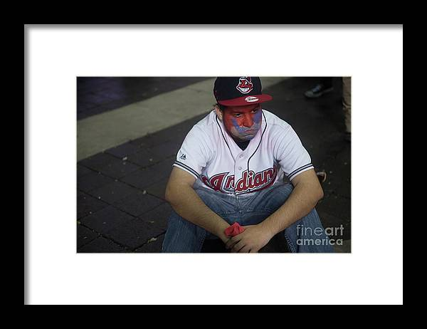 Cleveland Indians Framed Print featuring the photograph Cleveland Indians Fans Gather To The by Justin Merriman