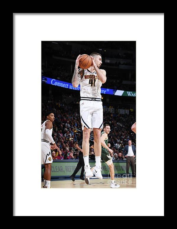 Nba Pro Basketball Framed Print featuring the photograph Milwaukee Bucks V Denver Nuggets by Garrett Ellwood