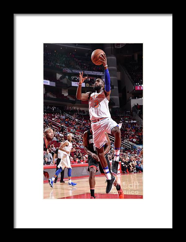 Tim Hardaway Jr. Framed Print featuring the photograph New York Knicks V Houston Rockets by Bill Baptist