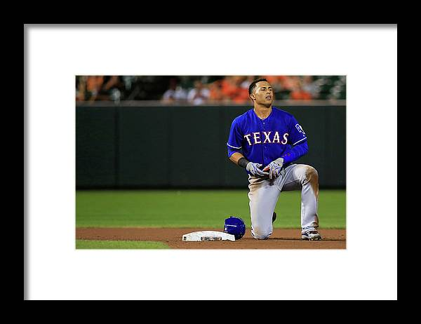 American League Baseball Framed Print featuring the photograph Texas Rangers V Baltimore Orioles by Rob Carr