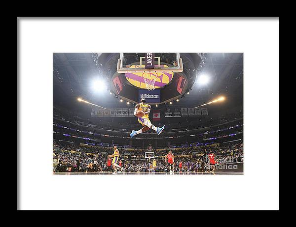 Nba Pro Basketball Framed Print featuring the photograph Lebron James Double-Clutch Reverse Dunk Tribute to Kobe Bryant by Andrew D. Bernstein